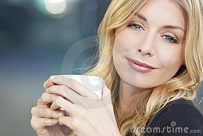 Beautiful Blond Woman Drinking Coffee