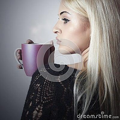 Beautiful blond woman drinking Coffee. Cup.tea. Hot drink