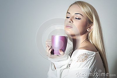 Beautiful blond woman drinking Coffee.Sweet girl in the Morning