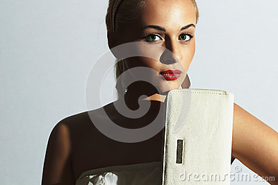 Beautiful blond woman.Fashion people.Stylish girl with white clutch.Red lips
