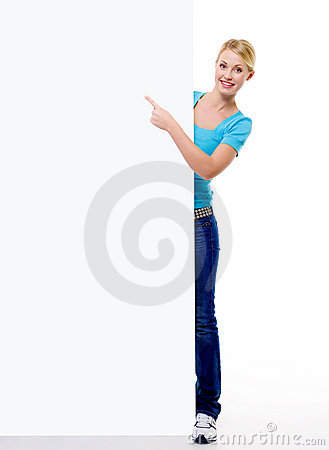 Beautiful blond woman  points  on the blank banner