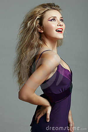 Beautiful blond woman in purple dress.