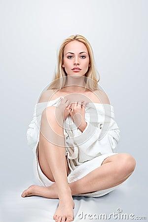 Beautiful blond woman sitting on