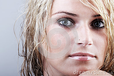 Beautiful blond woman with a sombre enigmatic gaze