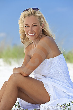 Beautiful Blond Woman in White Dress At Beach