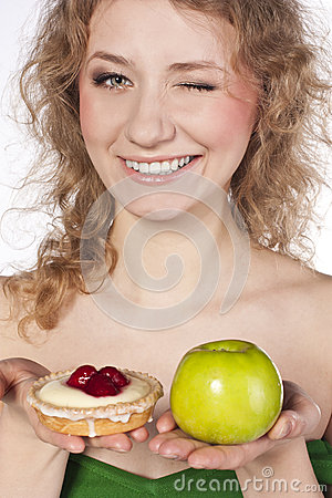 Beautiful blonde , between  apple and cake