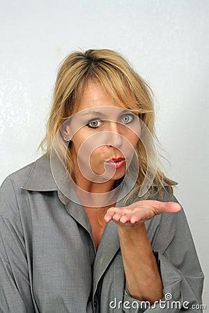 Beautiful Blonde Blows a Kiss