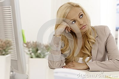 Beautiful blonde bored at workplace
