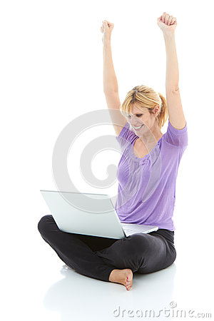 Beautiful blonde female with laptop  winning something online
