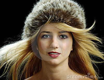 Beautiful blonde in fur hat with naked shoulders