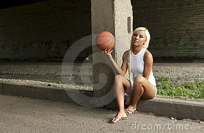 Beautiful blonde girl with basketball