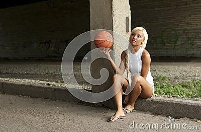 Beautiful blonde girl with basketball