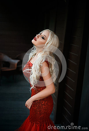 Free Beautiful Blonde Girl In A Luxurious Red Dress Royalty Free Stock Photo - 76417045