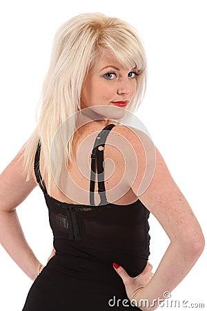 Beautiful blonde girl looking back over shoulder