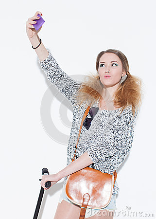 Free Beautiful Blonde Girl Making Selfie Duckface With Vintage Bag On His Shoulder. Close Up. Indoor. Stock Photo - 48000000