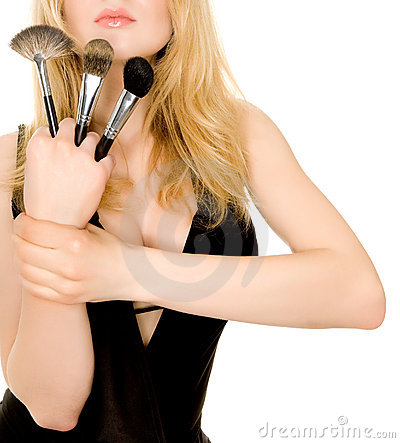 Beautiful blonde holding brushes