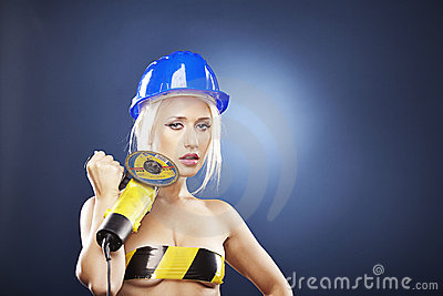 Beautiful blonde model with angle grinder