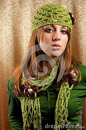 Beautiful blonde in retro cap and scarf