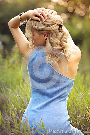 Beautiful blonde shows graceful back