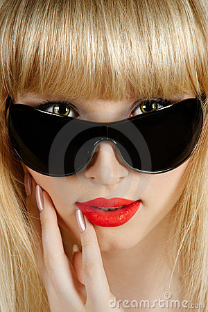Beautiful blonde in sunglasses closeup portrait