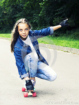 Free Beautiful Blonde Teen Girl In Jeans Shirt, On Skateboard In Park Royalty Free Stock Photography - 97450247