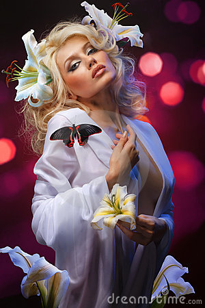 Beautiful blonde and tropical butterfly