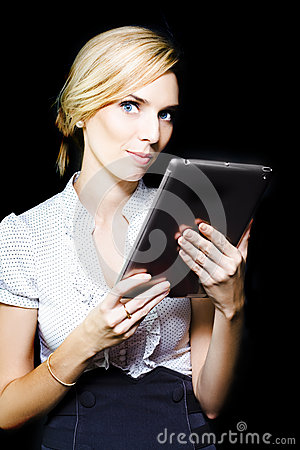 Beautiful blonde using a touch screen tablet