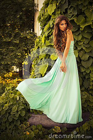 Free Beautiful Blonde With A Long Curly Hair In A Long Evening Dress In Static Outdoors Near Retro Vintage Building In Summer Sunset Royalty Free Stock Images - 47957019