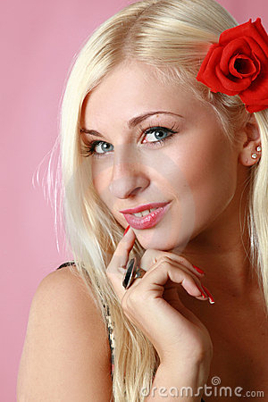 Free Beautiful Blonde With Red Flower In Hair Royalty Free Stock Photos - 7337928