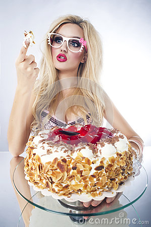 Beautiful blonde woman with a cake