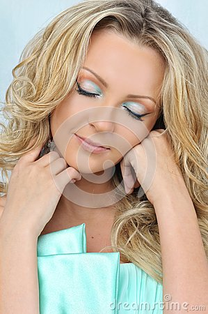 Beautiful blonde woman with closed eyes.