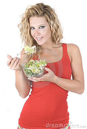 Beautiful blonde woman eating a sane vegetable sal