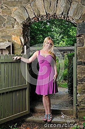 Beautiful Blonde woman in fuchsia dress