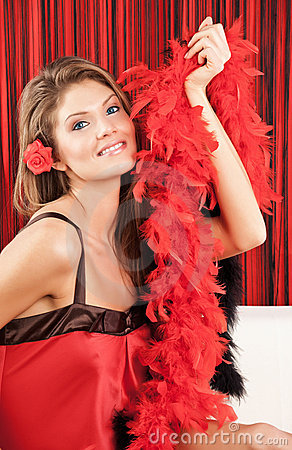 Beautiful blonde woman holding a red boa