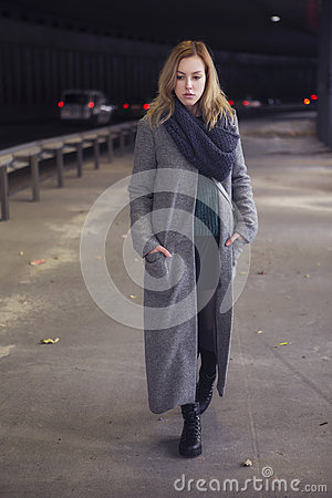 Free Beautiful Blonde Woman In Long Grey Warm Coat, Skirt, Boots And Royalty Free Stock Photography - 63866557