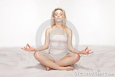 Beautiful blonde woman meditating