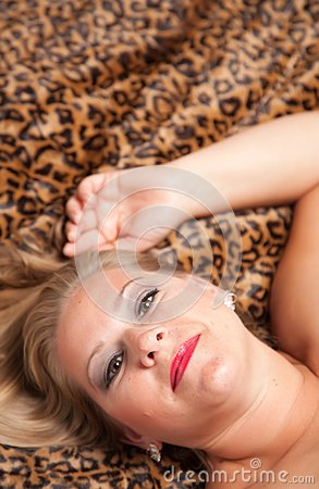 Beautiful Blonde Woman Poses on Leopard Blanket.