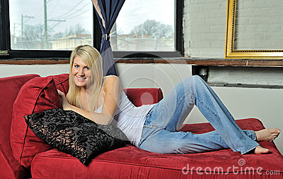 Beautiful blonde woman relaxing on couch