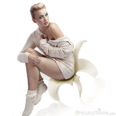 Beautiful blonde woman sitting with a wool sweater