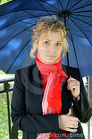 Beautiful blonde woman with umbrella