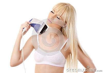 Beautiful blonde woman using massager