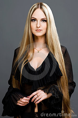 Beautiful blonde woman with very long hair.
