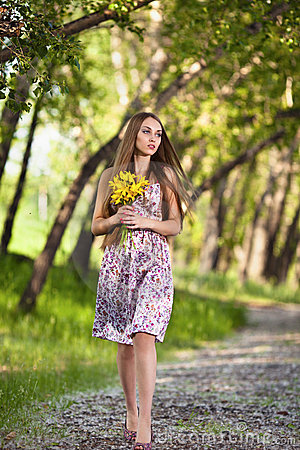 Beautiful blonde woman with yellow flowers