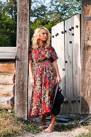 Beautiful blondie in the wooden gate