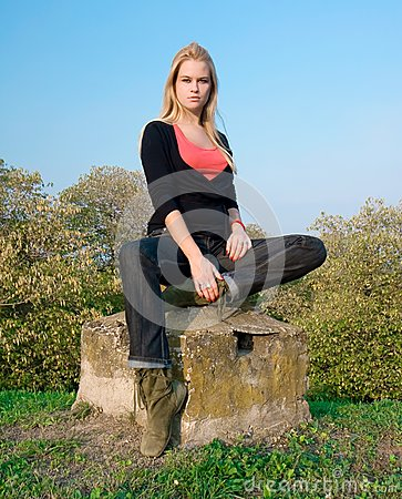 Beautiful blondy woman posing on autumn