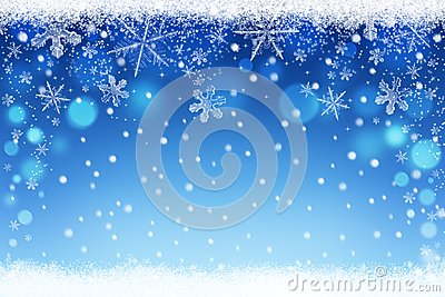 Beautiful blue blurred Christmas and Winter snow sky bokeh background with crystal snowflakes Stock Photo