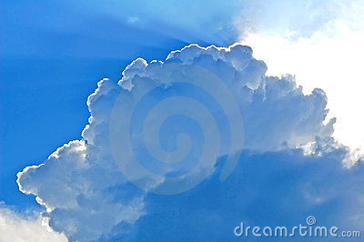 Beautiful blue clouds with the sun hiding