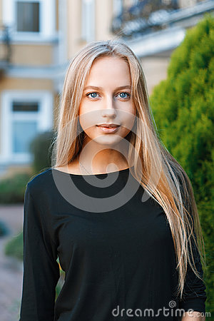 Free Beautiful Blue-eyed Girl On The Background Of Houses Stock Photos - 98725593