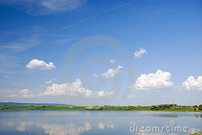 Beautiful blue water lake with sky reflection