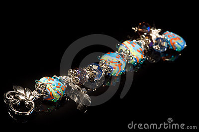 Beautiful bracelet of colored glass and silver